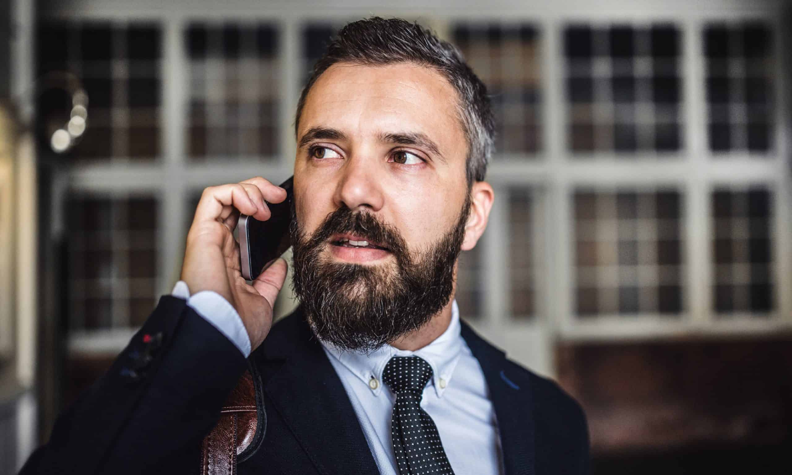 a-close-up-of-businessman-with-smartphone-SwitchVoip